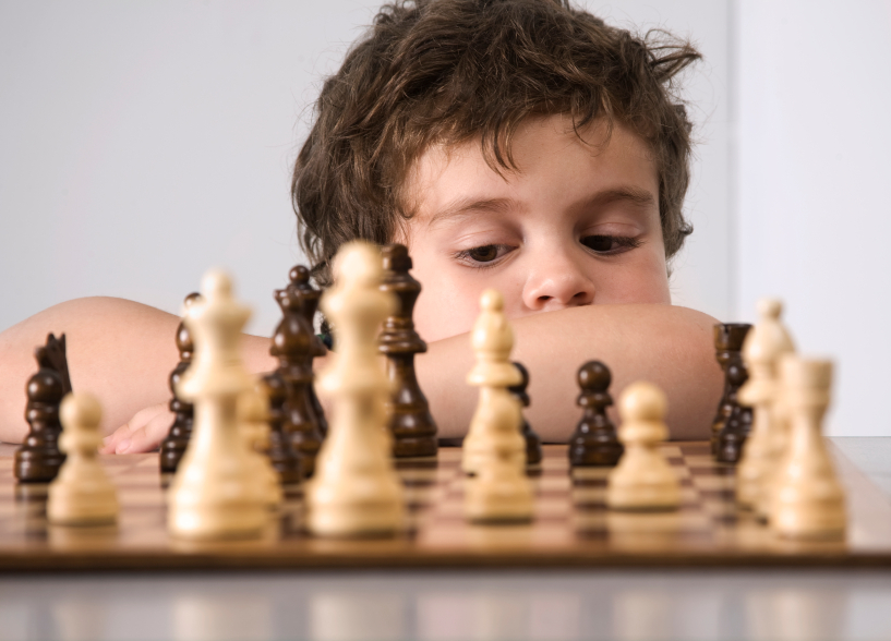 Autistic kid playing chess